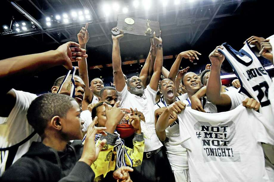 The Hillhouse Academics celebrates their back-to-back titles in the CIAC class LL state championship win defeating the East Hartford Hornets, 78-58, Saturday, March 18, 2017, at Mohegan Sun Arena in Uncasville. (Catherine Avalone/New Haven Register) Photo: Catherine Avalone/New Haven... / Catherine Avalone/New Haven Register