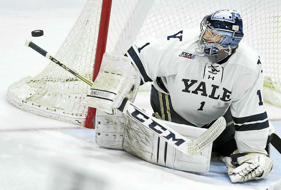 Yale goalie Sam Tucker makes one of his 24 saves against Brown on Saturday. Photo: Catherine Avalone — Register   / Catherine Avalone/New Haven Register