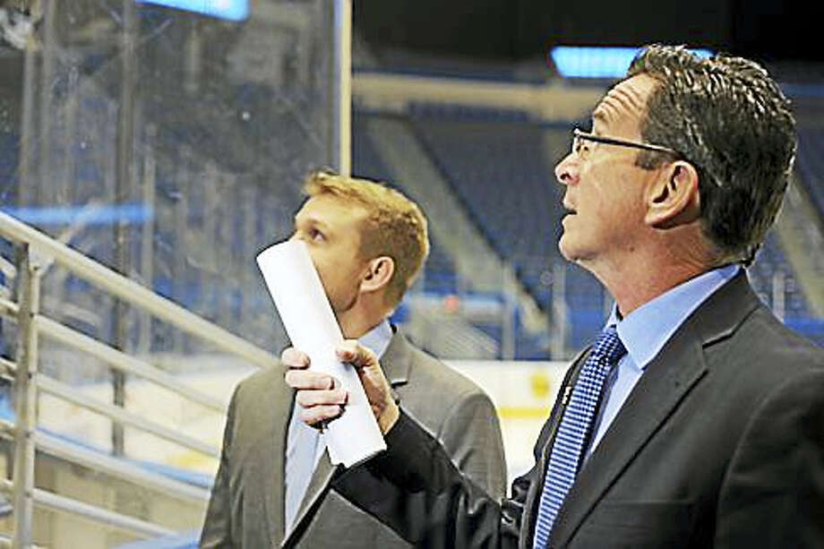 Gov. Dannel P. Malloy gets a tour of the XL Center in Hartford with General Manager Chris Lawrence. Photo: CTNEWSJUNKIE
