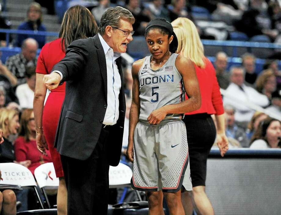 UConn coach Geno Auriemma talks with Crystal Dangerfield during a game earlier this season. Photo: Jessica Hill — The Associated Press File Photo   / AP2017