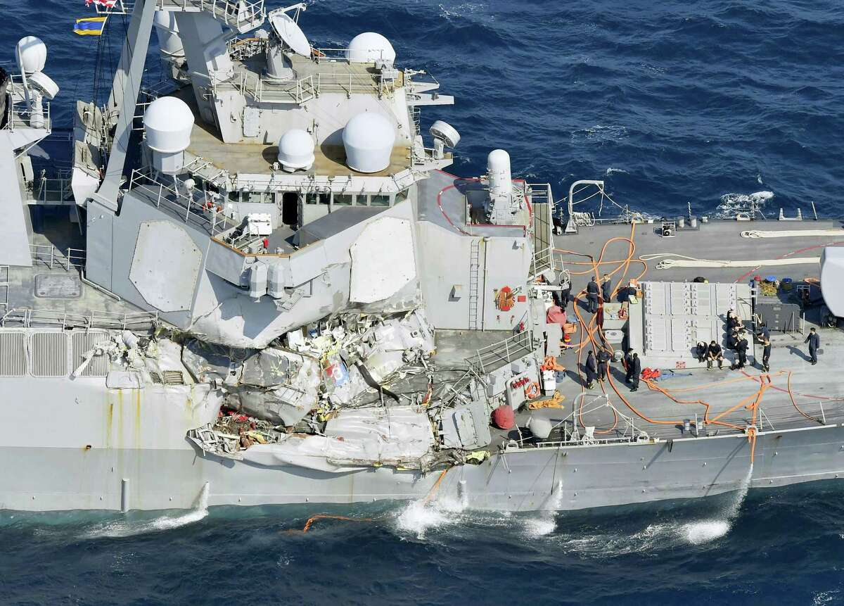 The damage of the right side of the USS Fitzgerald is seen off Shimoda, Shizuoka prefecture, Japan, after the Navy destroyer collided with a merchant ship, Saturday, June 17, 2017. The U.S. Navy says the USS Fitzgerald suffered damage below the water line on its starboard side after it collided with a Philippine-flagged merchant ship.