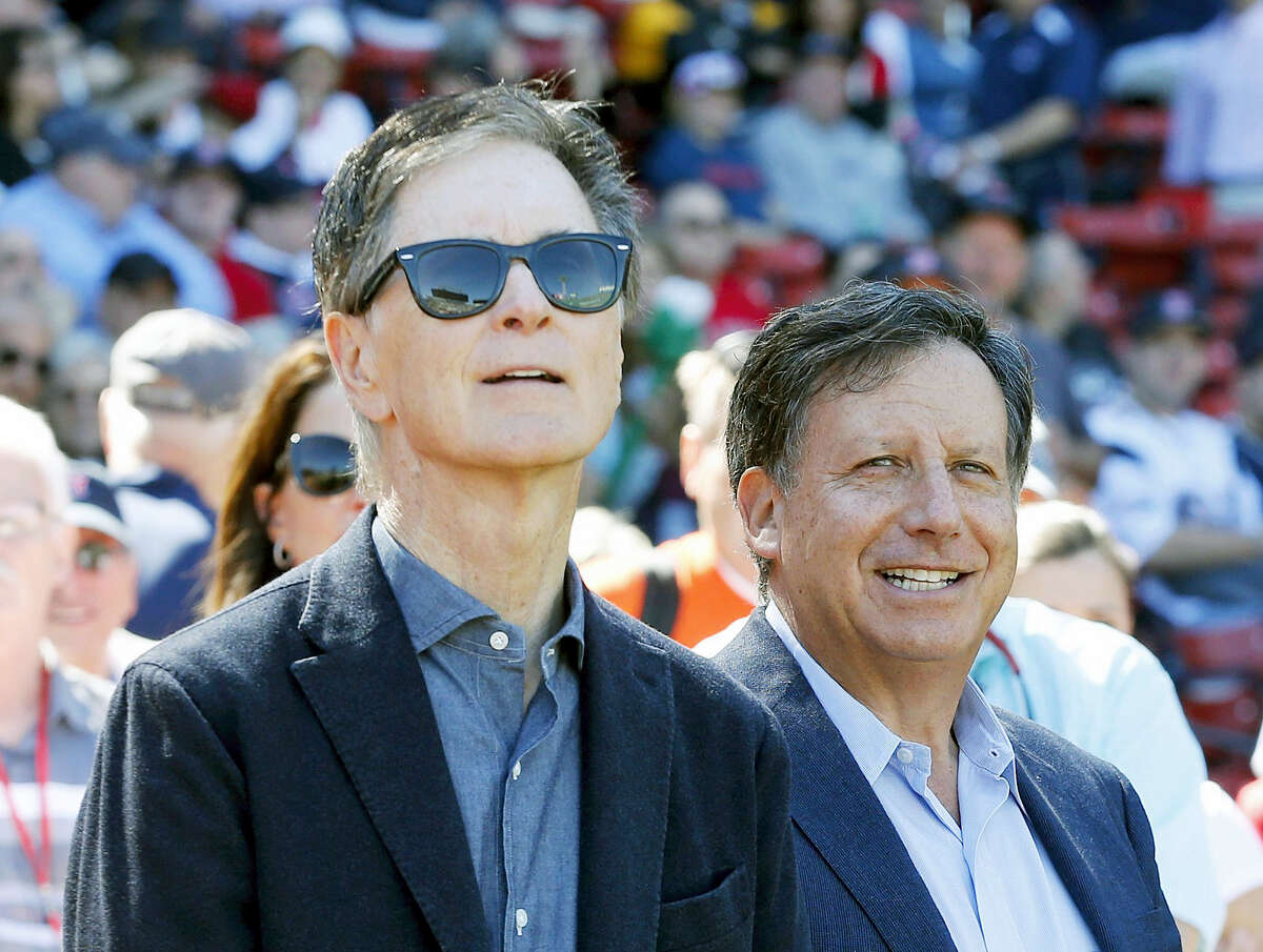 Boston Red Sox owners John Henry, left, and Tom Werner.