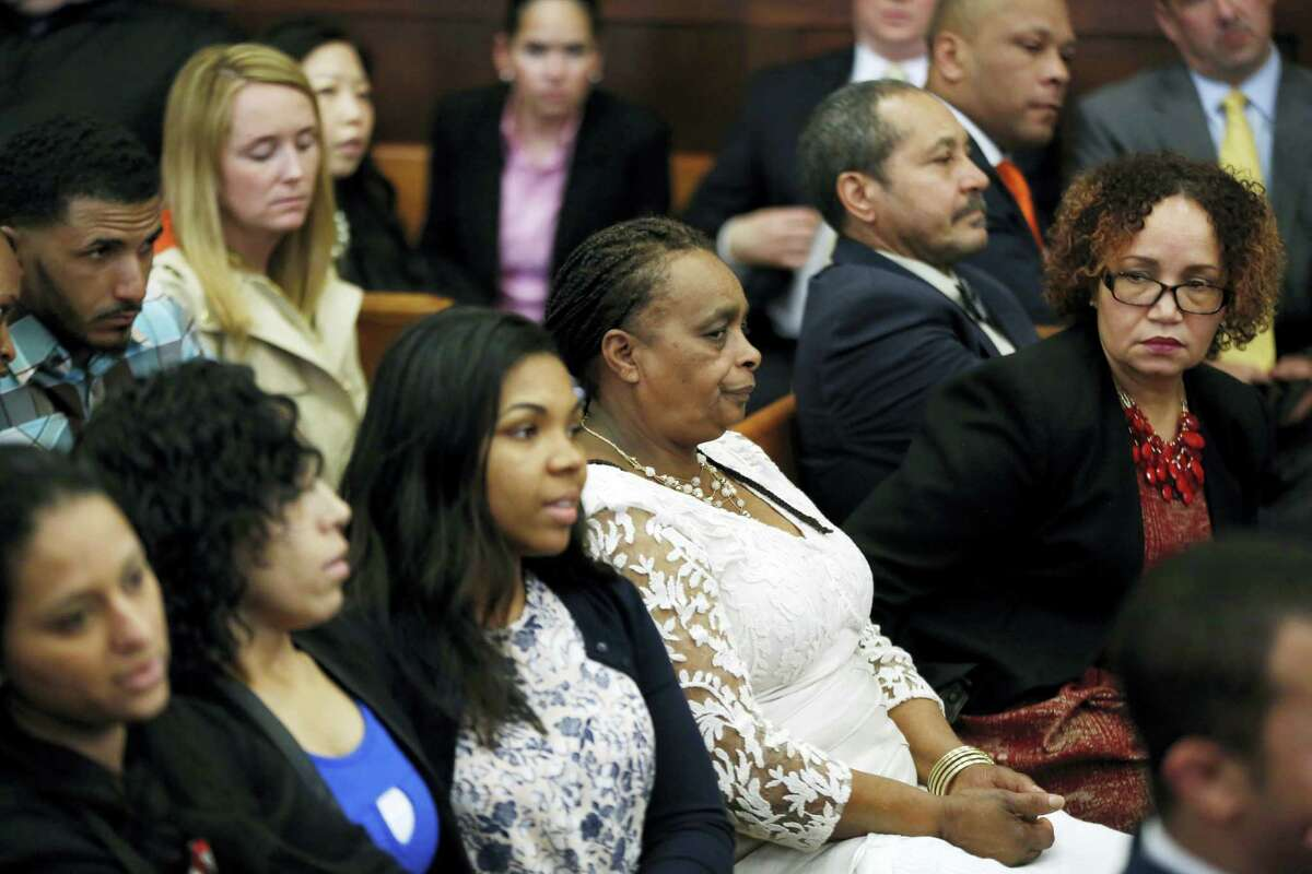 Family and friends of Daniel de Abreu and Safiro Furtado listen to the judge speak to the jury in defendant Aaron Hernandez's trial at Suffolk Superior Court, Tuesday, April 11, 2017, in Boston. Hernandez is on trial for the July 2012 killings of Daniel de Abreu and Safiro Furtado who he encountered in a Boston nightclub. The former New England Patriots NFL player is already serving a life sentence in the 2013 killing of semi-professional football player Odin Lloyd.