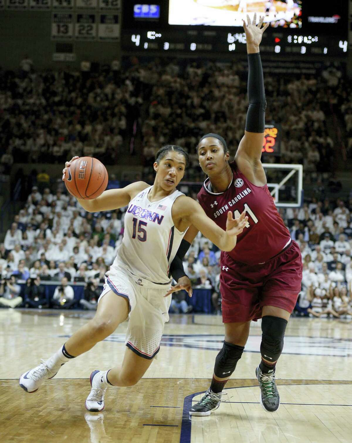 UConn's Gabby Williams drives to the basket as South Carolina's Alaina Coates, right, defends during Monday's game.