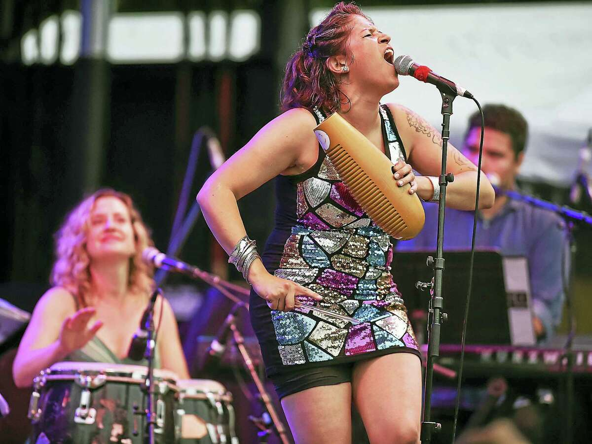 Catherine Avalone / Hearst Connecticut Media Fulaso, a 10-piece multi-cultural band led by vocalist Erica Ramos performs funky, latin, soul classics of the sixties and seventies, Saturday at the International Festival of Arts & Ideas on the New Haven Green.
