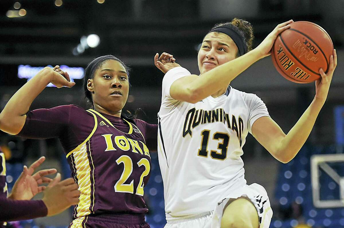 Quinnipiac's Sarah Shewan elevates to the hoop as Iona's Amelia Motz defends during Friday's game at the TD Bank Sports Center in Hamden.