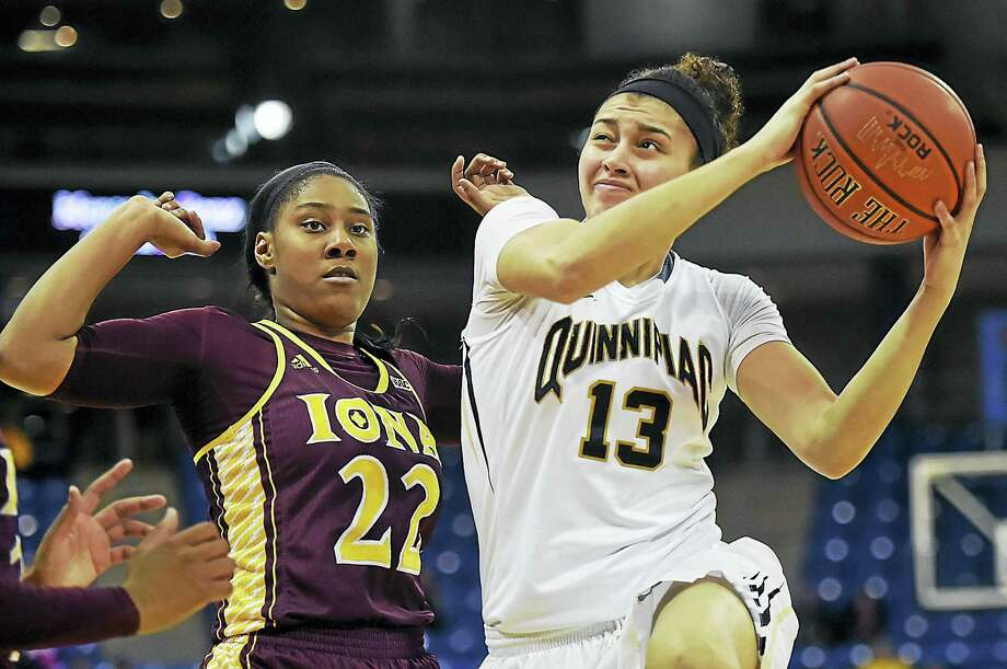 Quinnipiac's Sarah Shewan elevates to the hoop as Iona's Amelia Motz defends during Friday's game at the TD Bank Sports Center in Hamden. Photo: Catherine Avalone — Register   / Catherine Avalone/New Haven Register