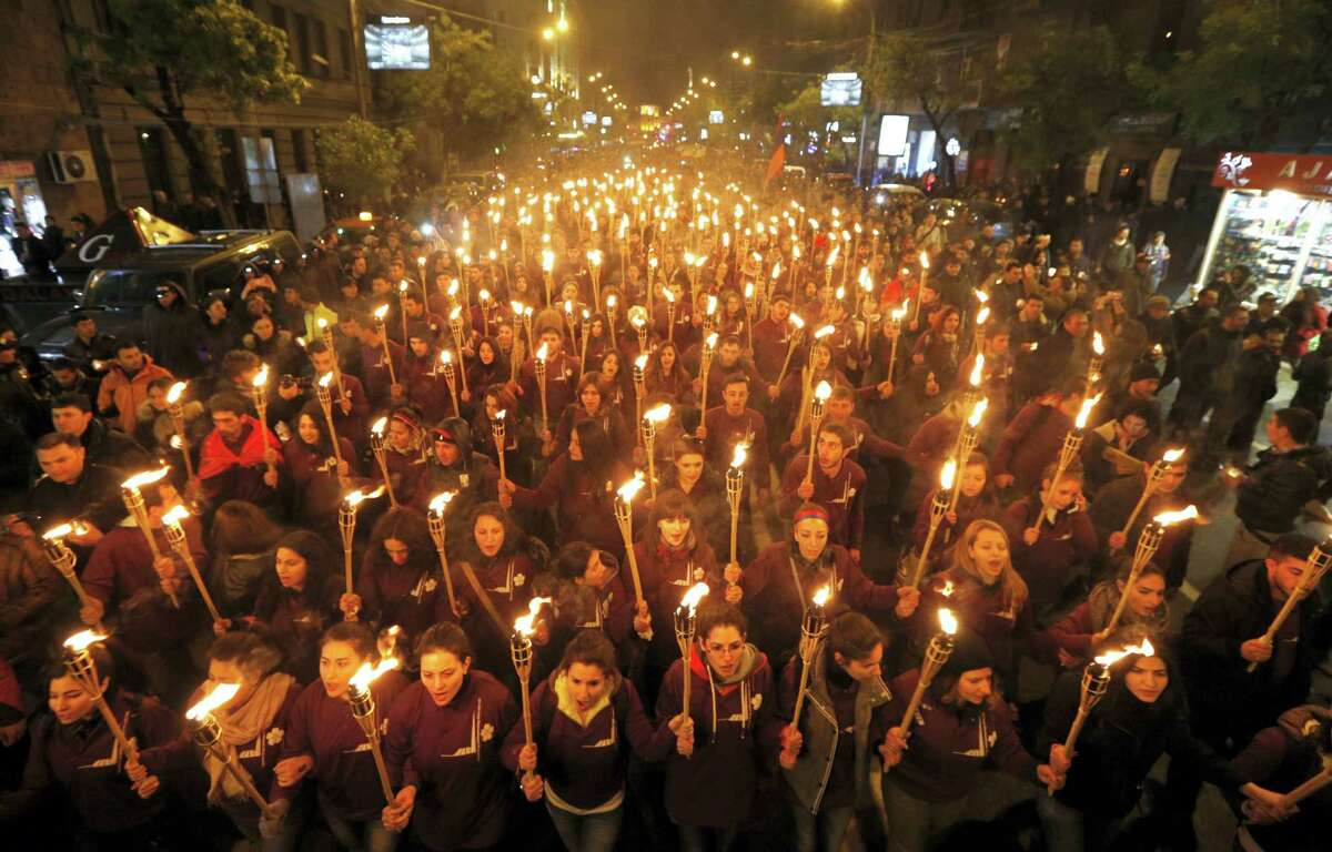 Armenians walk with torches to the monument to the victims of mass killings by Ottoman Turks, in Yerevan, Armenia, April 24, 2015.