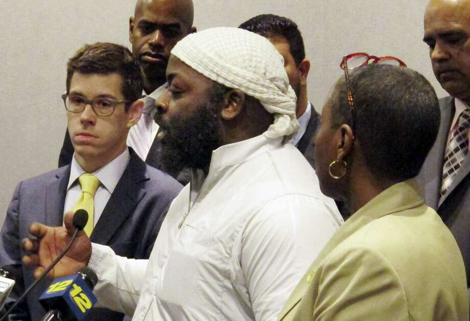 Isa Mujahid, center, of CTCORE-Organize Now!, speaks during a news conference at the Legislative Office Building May 16, 2017 in Hartford, Conn. Beside him are David McGuire, left, executive director of the American Civil Liberties Union of Connecticut, and state Rep. Robyn Porter, right, of New Haven. The group urged the legislature to pass a bill aimed at improving investigations of shootings involving police after an officer shot and killed an unarmed 15-year-old boy who was driving a stolen car in Bridgeport last week. Photo: AP Photo — Dave Collins   / Copyright 2017 The Associated Press. All rights reserved.