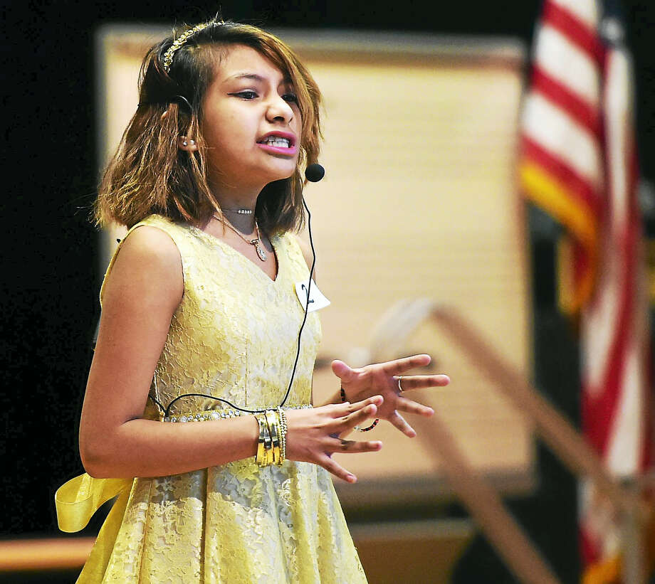 Hill Central School sixth-grader Kaitlyn Coronaperforms during the Voices of Hill Central Poetry Slam Wednesday in New Haven. Photo: Peter Hvizdak — New Haven Register   / ©2017 Peter Hvizdak