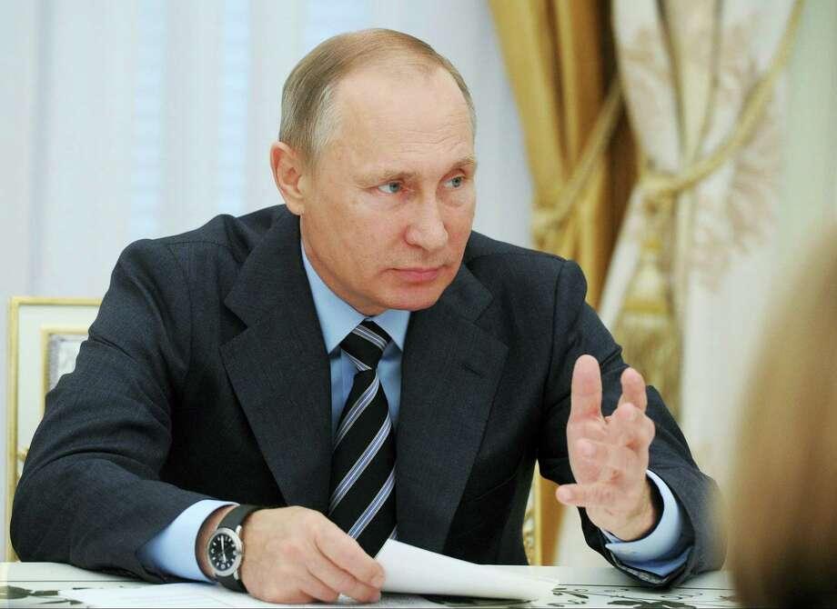 \In this Sept. 23, 2016, file-pool photo, Russian President Vladimir Putin speaks in the Kremlin in Moscow, Russia. Photo: Mikhail Klimentyev/Sputnik, Kremlin Pool Photo Via AP    / POOL SPUTNIK KREMLIN
