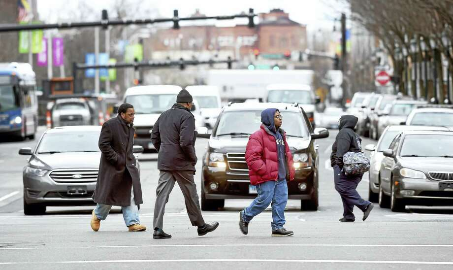 Pedestrians cross the intersection of Church Street and Chapel Street in New Haven. Photo: Arnold Gold — New Haven Register