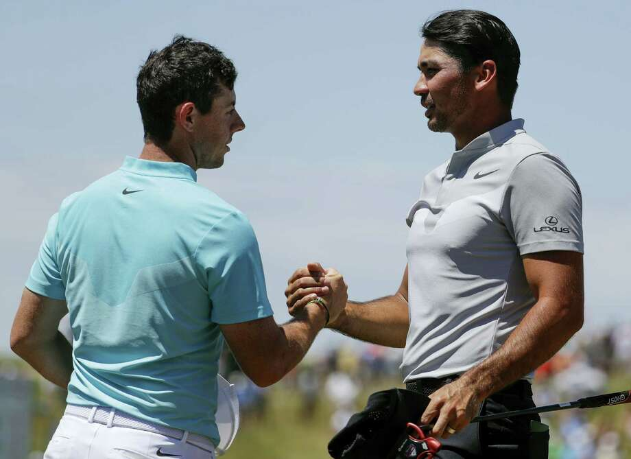 Jason Day, right, and Rory McIlroy shake hands after the second round of the U.S. Open. Both are committed to play in next week's Travelers Championship in Cromwell. Photo: Chris Carlson — The Associated Press   / Copyright 2017 The Associated Press. All rights reserved.