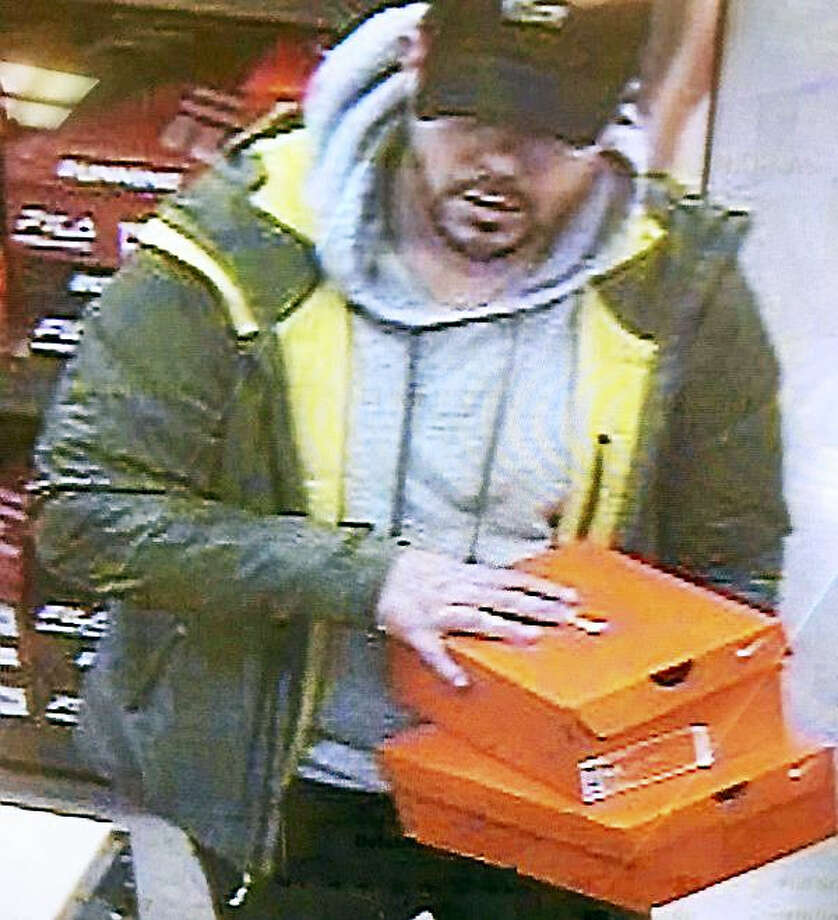 Police are looking for a man who allegedly walked out of Bob's on Dixwell Avenue wearing stolen sneakers then fought with an employee when they tried to stop him. Photo: Photo Courtesy Of The Hamden Police Department