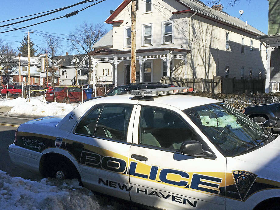 City police are investigating after a New Haven man was shot in the leg late Friday morning. Police could be seen gathering clues in a home at 197 James St. early Friday afternoon. Photo: Wes Duplantier — New Haven Register