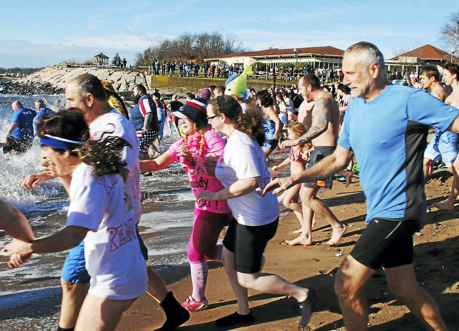 Nearly 200 people participated in the 17th annual Icy Plunge for the Cure Saturday. The event, which was held on the beach behind the Savin Rock Conference Center at 6 Rock St., raises money for breast cancer research and education. Photo: Viktoria Sundqvist — New Haven Register