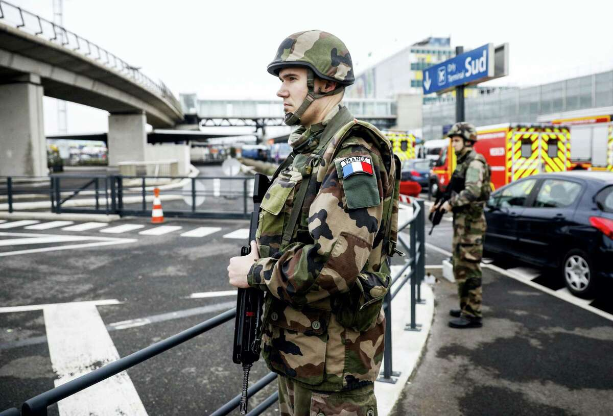Soldiers patrol at Orly airport, south of Paris, Saturday, March, 18, 2017. Soldiers at Paris' busy Orly Aiport shot and killed a man who wrestled one of their colleagues to the ground and tried to steal her rifle Saturday, officials said. (AP Photo/Kamil Zihnioglu)