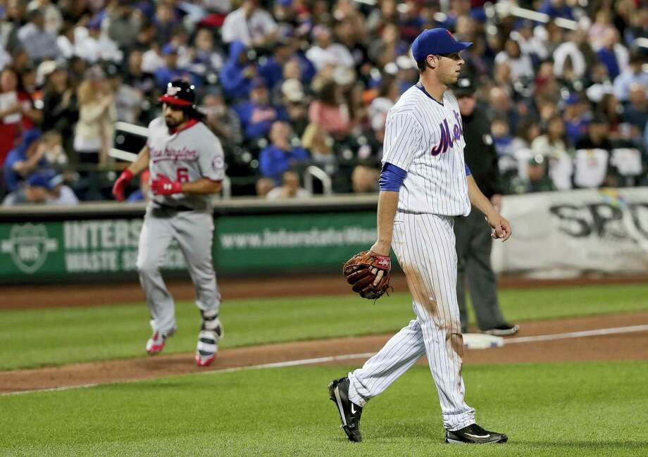 Mets pitcher Steven Matz, right, walks back to the mound after giving up a two-run home run to Anthony Rendon on Friday. Photo: Julie Jacobson — The Associated Press   / Copyright 2017 The Associated Press. All rights reserved.