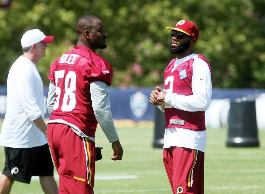 Washington Redskins cornerback DeAngelo Hall, right, talks with teammate Junior Galette during the teams NFL football training camp in Richmond, Va. on Aug. 1, 2015. Photo: AP Photo — Jason Hirschfeld   / FR170070 AP