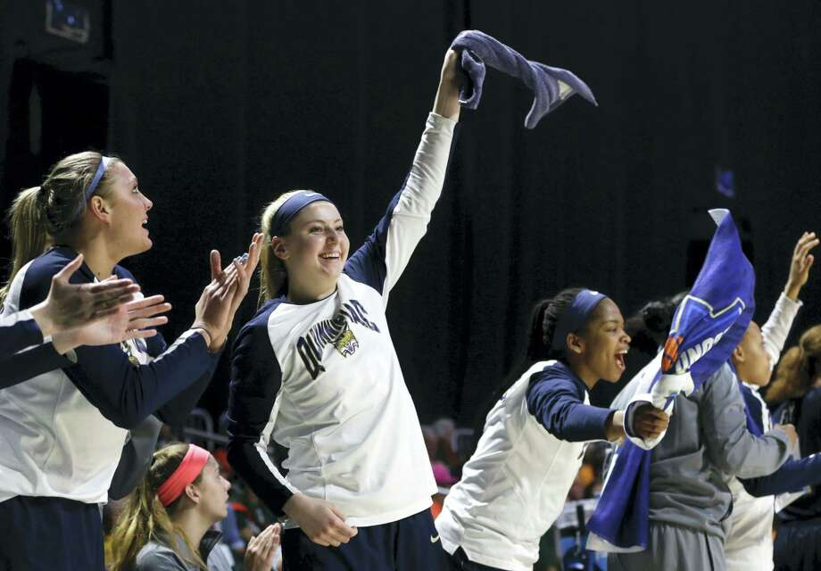 Quinnipiac players on the bench celebrate during the second half of Saturday's win over Marquette in the first round of the NCAA Tournament in Coral Gables, Fla. Photo: Lynne Sladky — The Associated Press   / Copyright 2017 The Associated Press. All rights reserved.