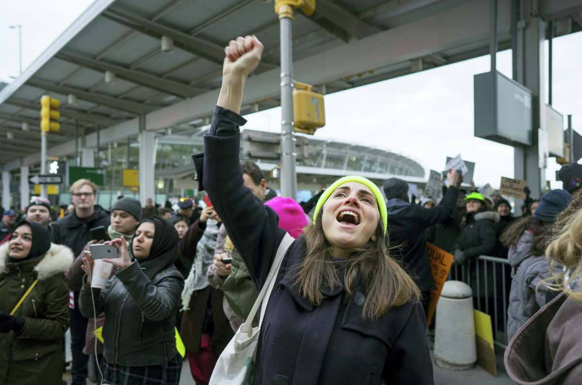 A protester raises her fist and shouts as she joins others assembled at John F. Kennedy International Airport in New York on Saturday after two Iraqi refugees were detained while trying to enter the country. On Friday, Jan. 27, President Donald Trump signed an executive order suspending all immigration from countries with terrorism concerns for 90 days. Countries included in the ban are Iraq, Syria, Iran, Sudan, Libya, Somalia and Yemen, which are all Muslim-majority nations.