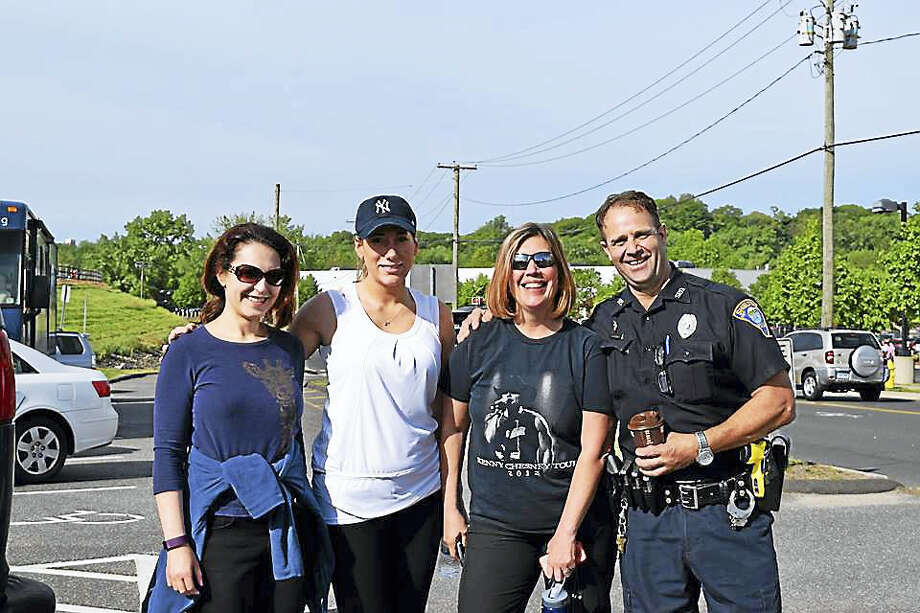 A Derby police officer with a group of walkers at last year's event. Photo: Contributed