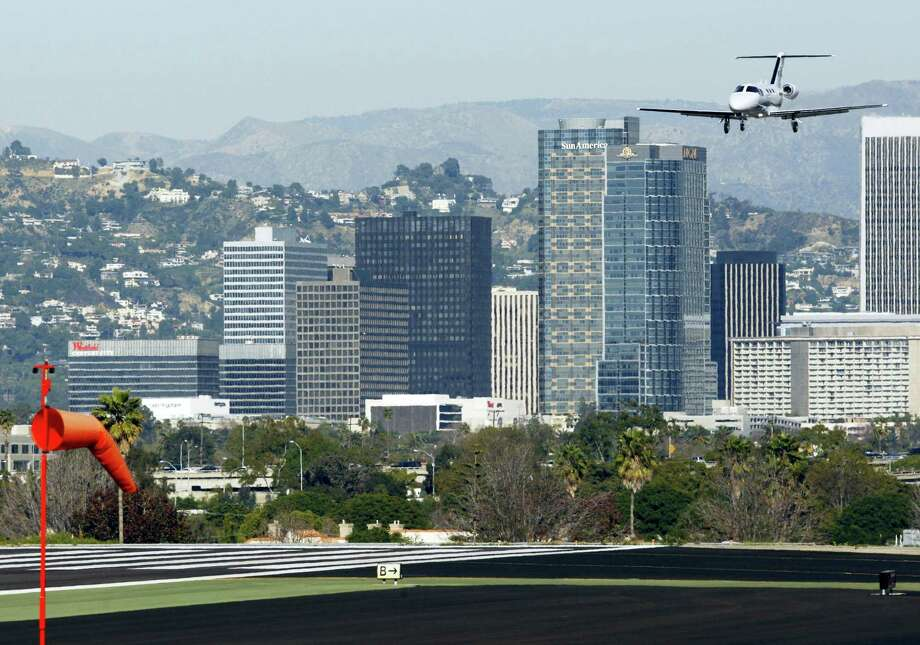An aircraft approaches Santa Monica Airport in Santa Monica, Calif. in 2011. The city said Saturday that it has reached an agreement with the federal government to close the airport in December, 2028. Photo: Damian Dovarganes — AP File Photo / AP2011