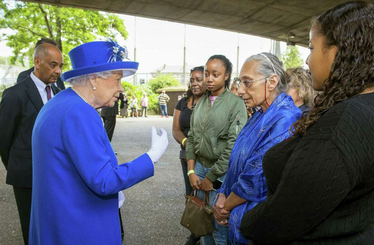 Queen Elizabeth II meets members of the community affected by the fire at Grenfell Tower during a visit to the Westway Sports Centre which is providing temporary shelter for those who have been made homeless by the fire at Grenfell Tower, in London, Friday June 16, 2017. Relatives of those missing after a high-rise tower blaze in London are searching frantically for their loved ones, as the police commander in charge of the investigation says he hopes the death toll will not rise to three figures.