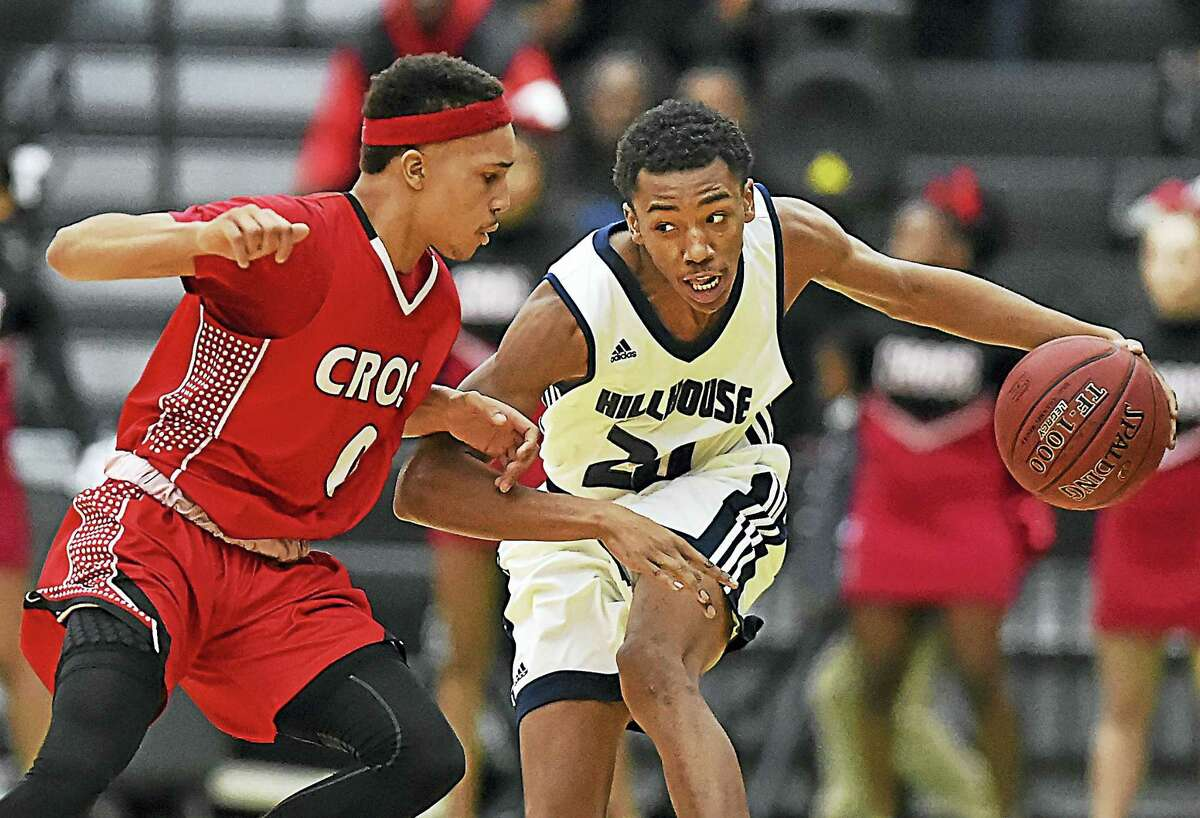 Hillhouse's J'Vaughn Hoover, right, drives past Wilbur Cross' Kwane Taylor during Thursday's game.
