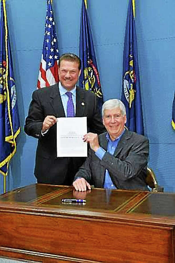 PHOTO COURTESY MICHIGAN HOUSE REPULICANS  Gov. Snyder today signs into law a bipartisan bill package reforming Michigan's civil asset forfeiture laws. Photo: Journal Register Co.