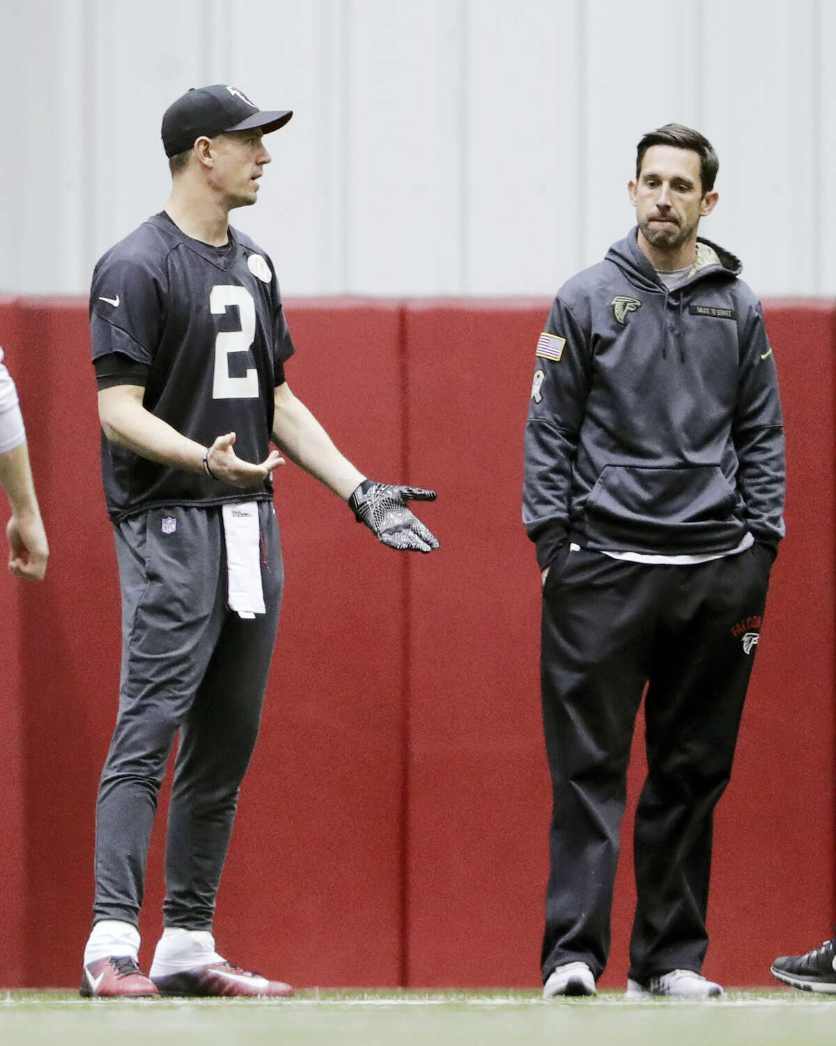 Falcons quarterback Matt Ryan, left, and offensive coordinator Kyle Shanahan will be up against the league's top-ranked scoring defense in the Patriots.
