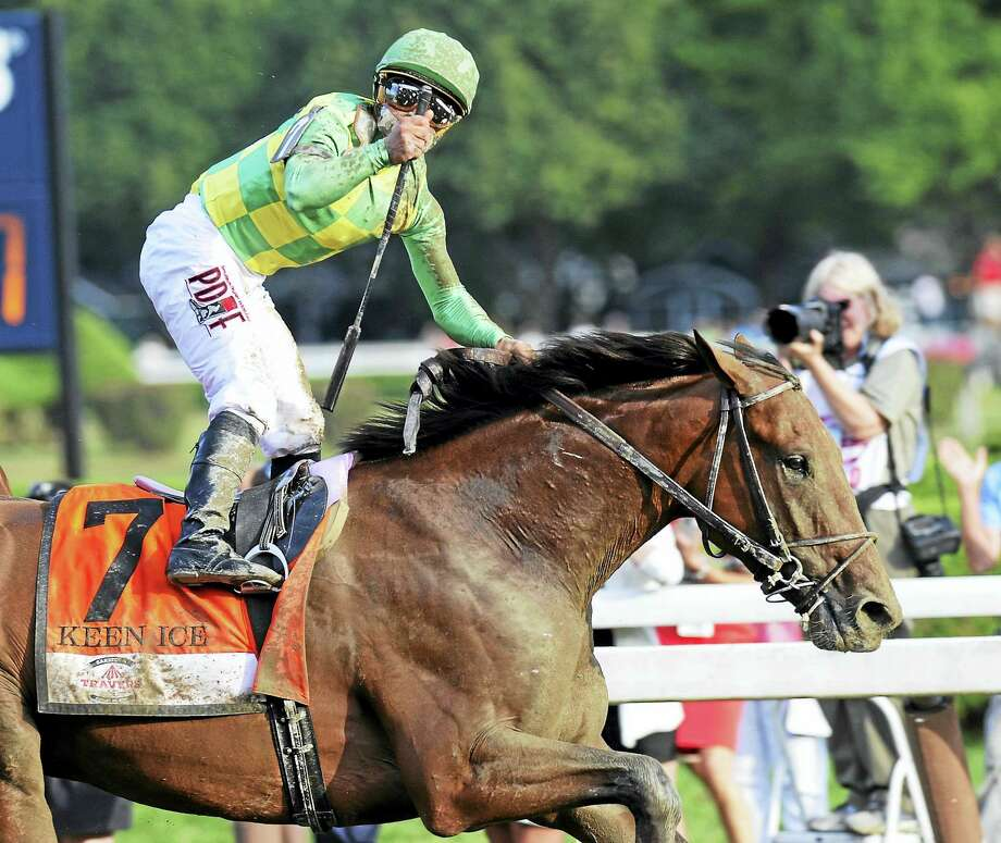 Kavier Castellano celebrates after Keen Ice defeated Triple Crown winner American Pharoah to win the Travers Stakes in 2015. Photo: The Associated Press File Photo   / FR58980 AP