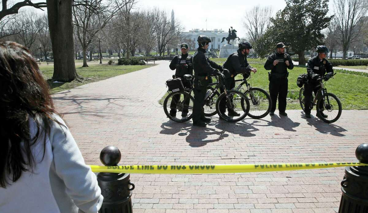 AP Photo/Alex Brandon US Secret Service officers stand in the cordoned off Lafayette Park after a security incident near the fence of the White House in Washington, Saturday, March 18, 2017. President Trump was not at the White House at the time of the incident.