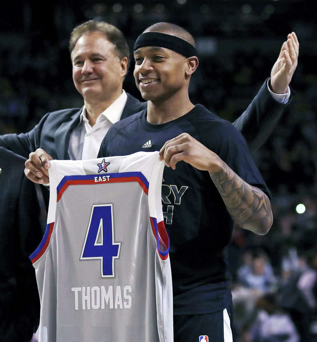 Boston Celtics guard Isaiah Thomas (4) holds up his NBA All Star jersey prior to the first quarter Wednesday. At rear is Celtics co-owner Steve Pagliuca.