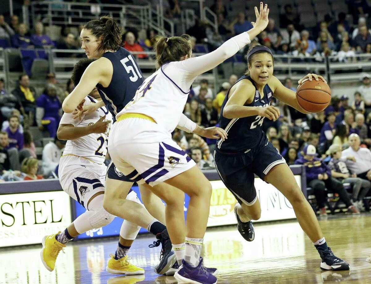 UConn's Napheesa Collier (24) drives around East Carolina's Kristen Gaffney during Tuesday's game.)