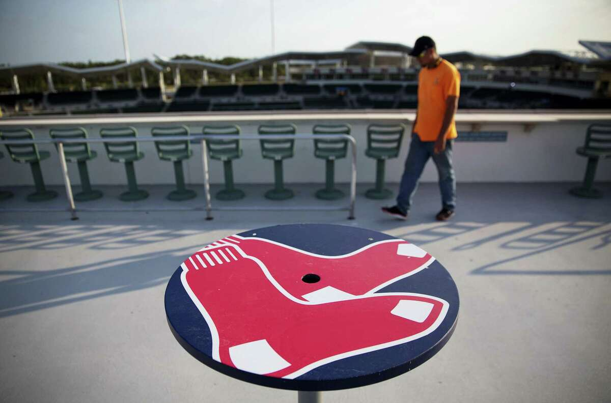 A table with a Boston Red Sox logo stands at JetBlue Park in Fort Myers, Fla.