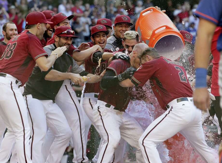 Arizona Diamondbacks Chris Herrmann, center, celebrates his walk-off home run during the 11th inning against the New York Mets, Wednesday The Diamondbacks won 5-4 to sweep the seaason series. Photo: MATT YORK — THE ASSOCIATED PRESS   / Copyright 2017 The Associated Press. All rights reserved.