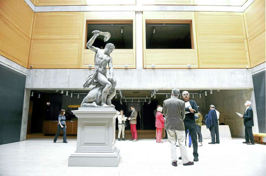 "A tour begins in the Entrance Court of the Yale Center for British Art in New Haven near a newly installed eighteenth century sculpture, ""Samson Slaying a Philistine,"" by John Cheere. Photo: Arnold Gold — New Haven Register/file"