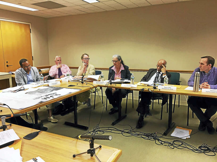 City Planner Karyn Gilvarg, center, addresses the City Plan Commission Wednesday night over whether it wanted to hold a special meeting on a zone change. Photo: MARY E. O'LEARY — NEW HAVEN REGISTER