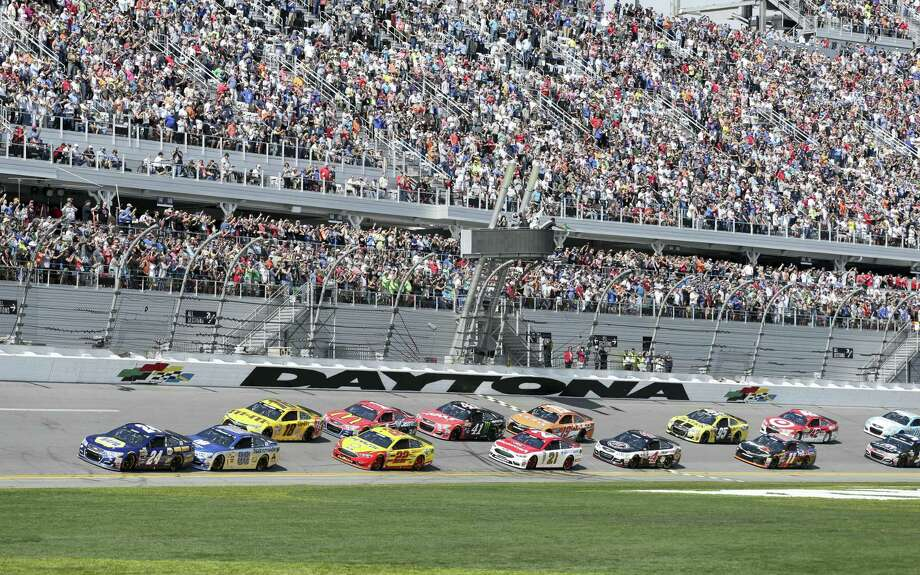 Chase Elliott (24) leads the field at the start of last year's Daytona 500. Photo: The Associated Press File Photo   / FR60642 AP