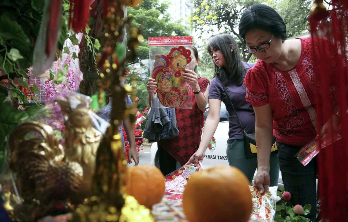 Indonesian ethnic Chinese women buy rooster decorations for Chinese New Year celebrations at the Chinatown in Jakarta, Indonesia on Friday. Chinese worldwide are preparing to celebrate the Year of the Rooster.