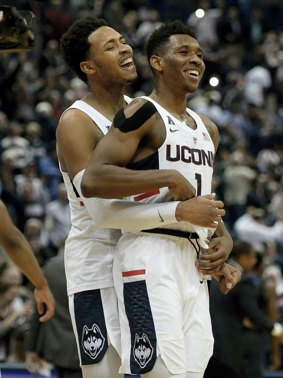 UConn's Jalen Adams, left, and Christian Vital celebrate their win over Memphis on Thursday.
