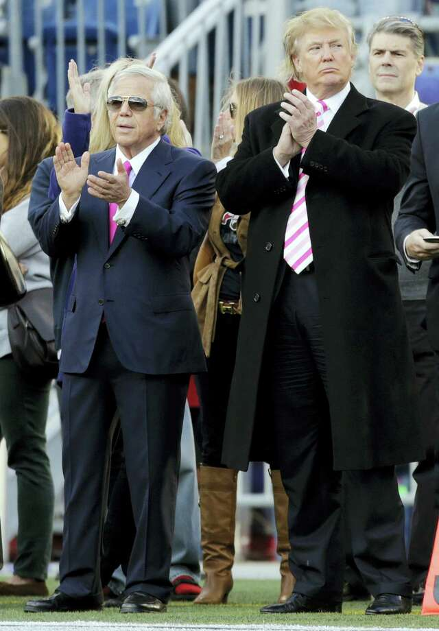 New England Patriots owner Robert Kraft, left, and businessman Donald Trump, right, applaud on the field before an NFL football game between the Patriots and the New York Jets in Foxborough, Mass. in 2012. In the six New England states that voted for Hillary Clinton, some Patriots fans are trying to reconcile their team allegiance with their distaste for Republican President Trump. The New York billionaire has made it no secret he's good friends with team owner Robert Kraft, head coach Bill Belichick and quarterback Tom Brady. New England faces the Atlanta Falcons in the Super Bowl on Feb. 5, 2017, in Houston. Photo: Charles Krupa — AP File Photo / AP2012