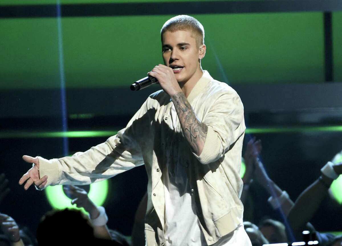 Justin Bieber performs at the Billboard Music Awards in Las Vegas. A Las Vegas man who says Bieber assaulted him in Cleveland eight months ago has filed a police report about the fracas.
