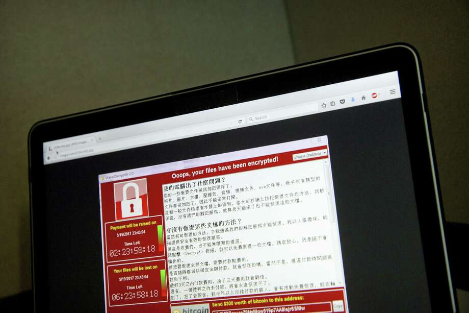 "In this May 13, 2017, file photo, a screenshot of the warning screen from a purported ransomware attack, as captured by a computer user in Taiwan, is seen on laptop in Beijing.  Global cyber chaos is spreading Monday, May 14,  as companies boot up computers at work following the weekend's worldwide ""ransomware"" cyberattack. The extortion scheme has created chaos in 150 countries and could wreak even greater havoc as more malicious variations appear. The initial attack, known as ""WannaCry,"" paralyzed computers running Britain's hospital network, Germany's national railway and scores of other companies and government agencies around the world. Photo: AP Photo/Mark Schiefelbein, File    / Copyright 2017 The Associated Press. All rights reserved."