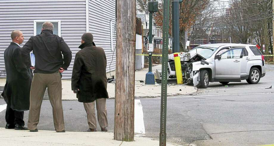 New Haven police were investigating Friday after a person was shot on Winchester Avenue near Compton Street. An SUV connected to the shooting crashed into a pole near the intersection with Compton Street. Photo: Wes Duplantier — New Haven Register