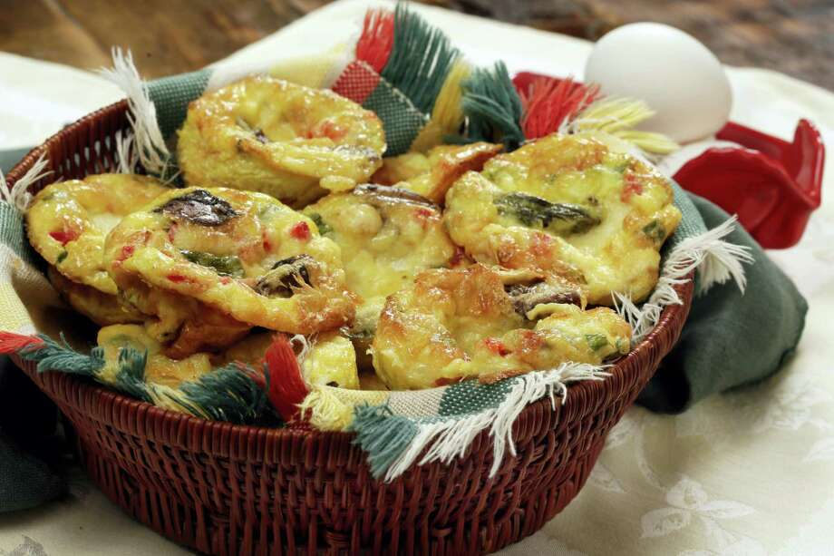 Baked muffin frittatas with asparagus and mushrooms Photo: Richard Drew — The Associated Press   / AP
