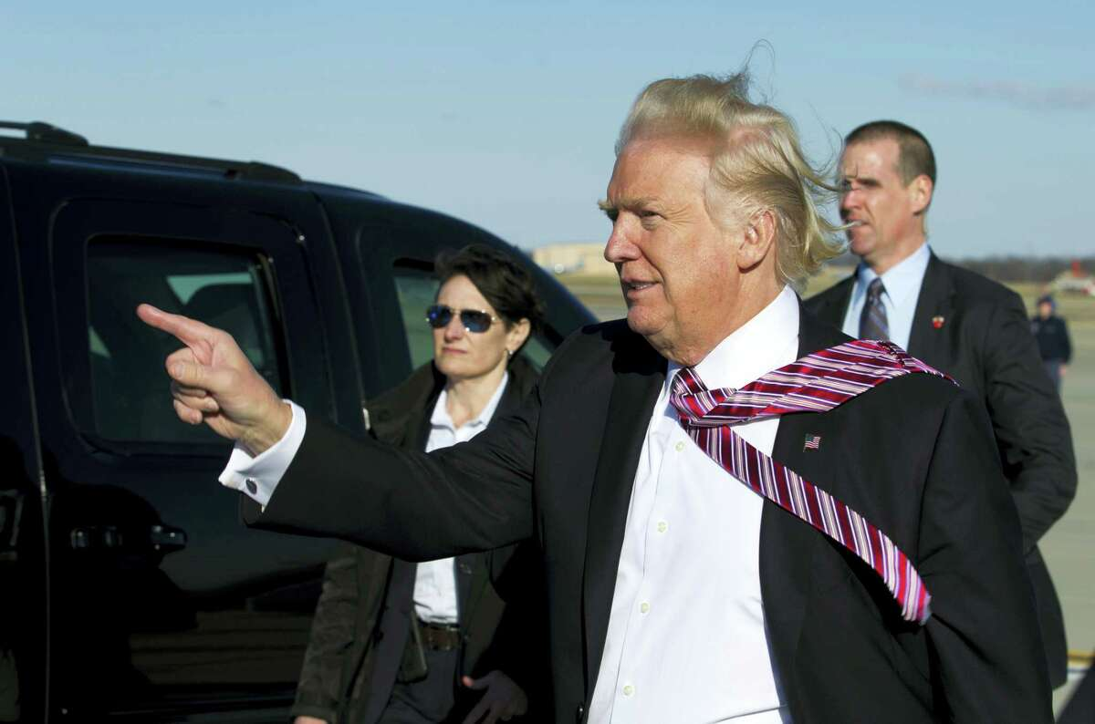 President Donald Trump points to guests upon his arrival at Andrews Air Force One, Md., on Thursday.