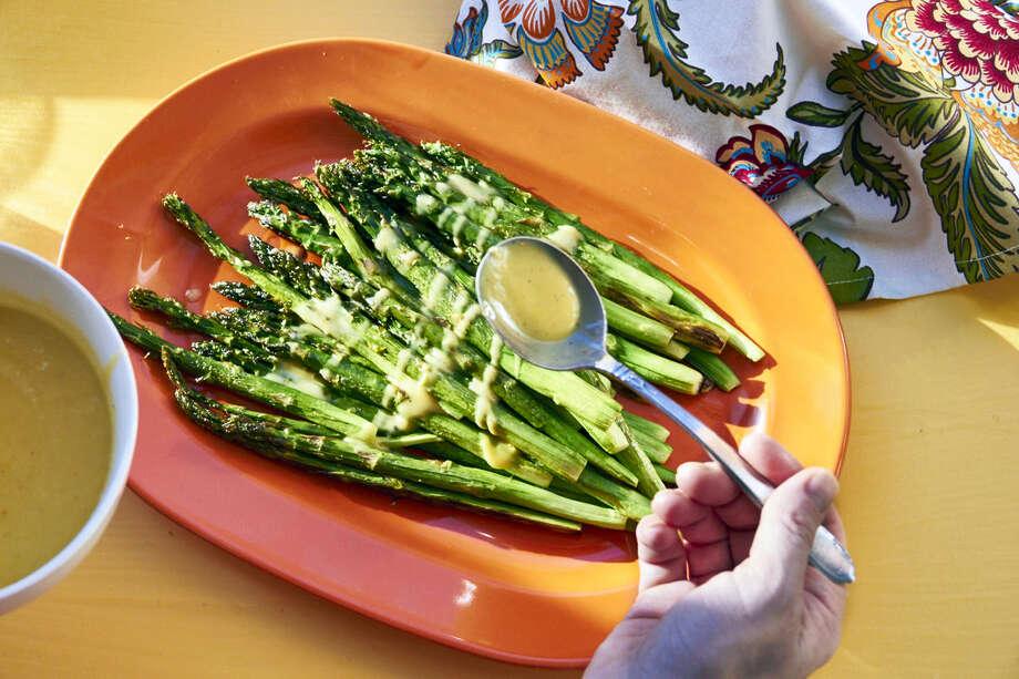 Roasted asparagus with creamy lemon dressing Photo: The Associated Press   / Mia