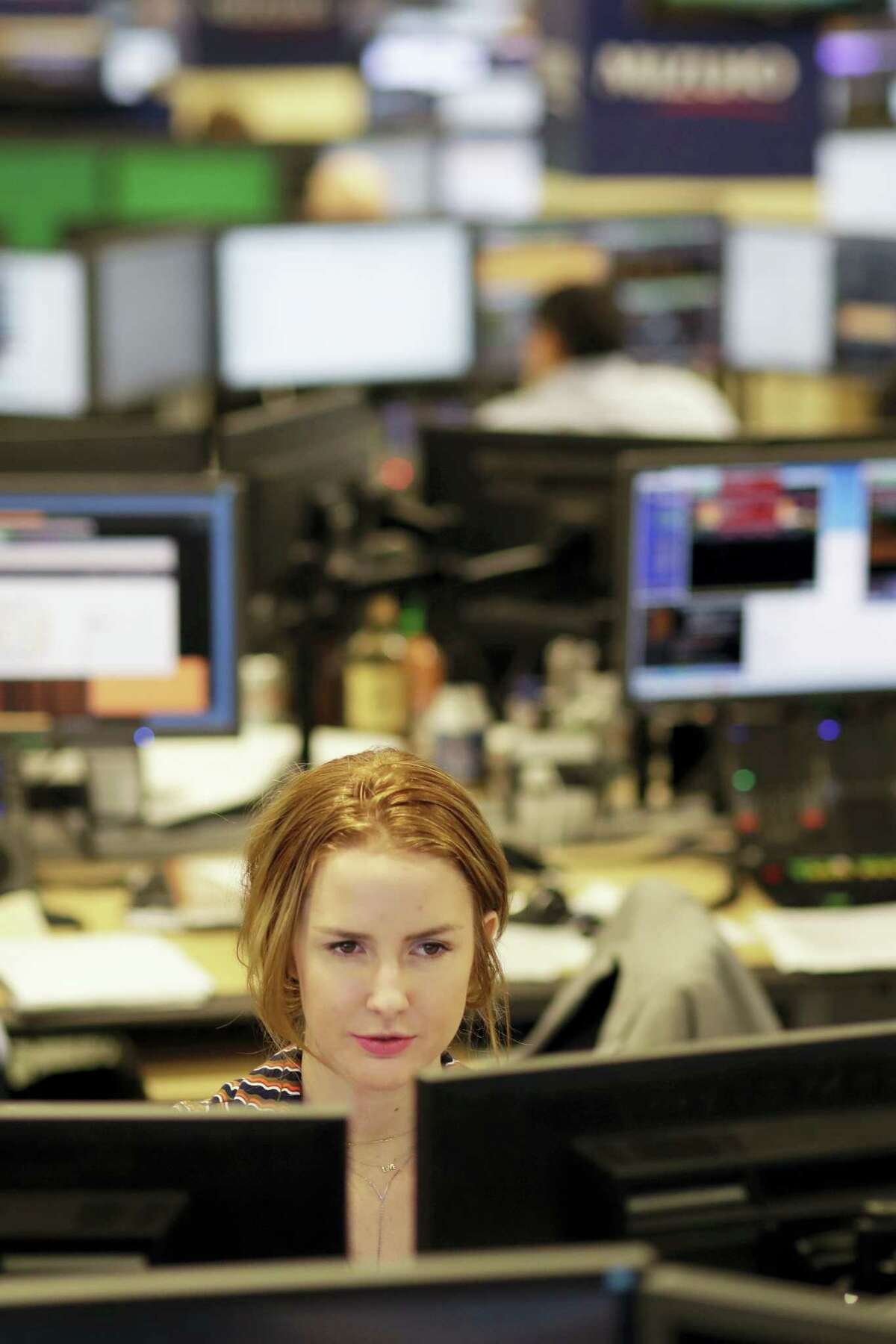 Traders work on the Mizuho Americas trading floor in New York.